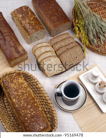 Various bakery goods and dark coffee - stock photo