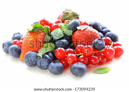 various berries - strawberry, currant, blueberry on white background - stock photo