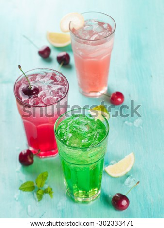 Various beverage (cocktail or lemonade)  with cherry, lemon and mint, selective focus - stock photo