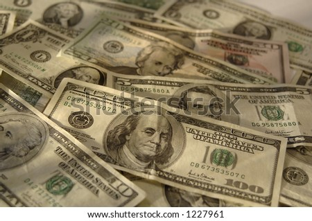 various bills laid out (shallow DOF) - stock photo