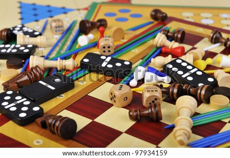 Various board games and many figurines background - stock photo