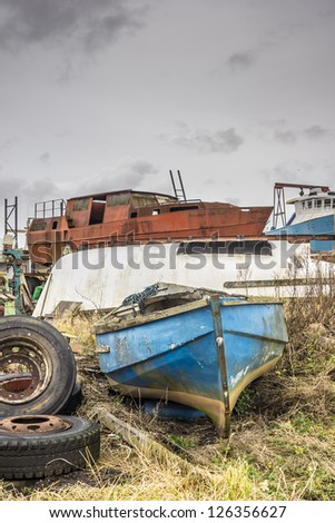 Various boats abandoned,and rotting & rusting away in a yard at Annan harbour