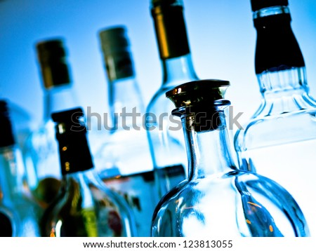 Various bottles at a bar arranged in rows - stock photo