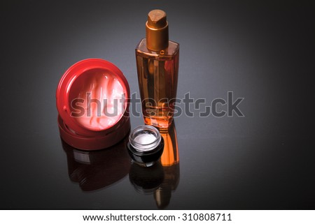 Various bottles of health and beauty products on grey background with reflection. Copy space for your text. Studio shot, Horizontal - stock photo