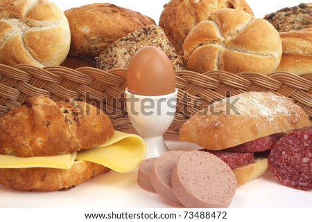 Various bread rolls against a white background