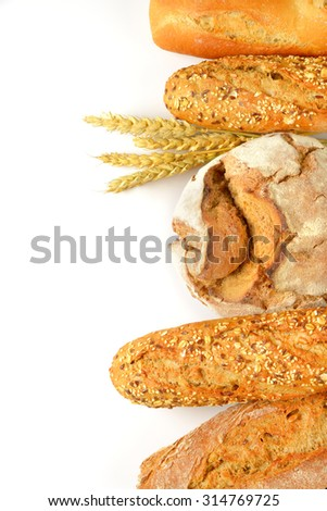 various breads on white background overhead