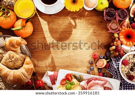 Various breakfast ingredients as border on table - stock photo