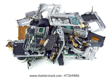 Various broken compact digital cameras parts prepared for processing. Isolated on white. Mass production. - stock photo