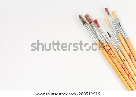 various brushes size on white paper - stock photo