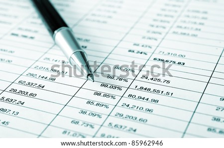 Various business stuff on a desk - blue toned image - stock photo