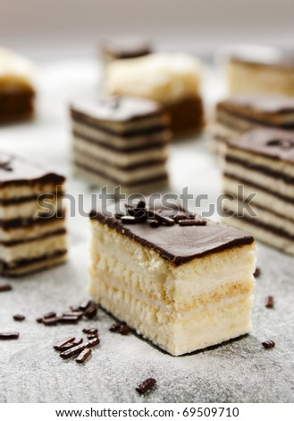 Various cake pieces of chocolate and vanilla filling. - stock photo