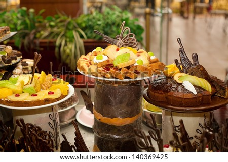 Various cakes on the buffet table - stock photo