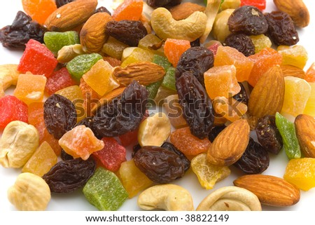 Various candied fruits and nuts on a white background. It is possible to use as wallpaper on a desktop