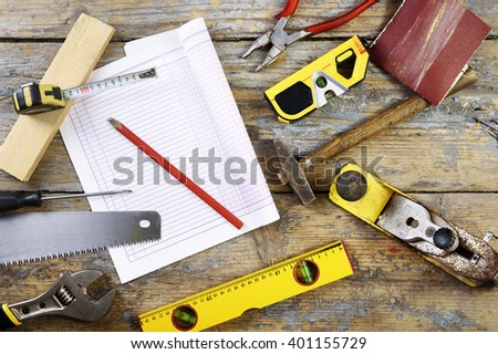 Various carpenter's tools on wooden table - stock photo