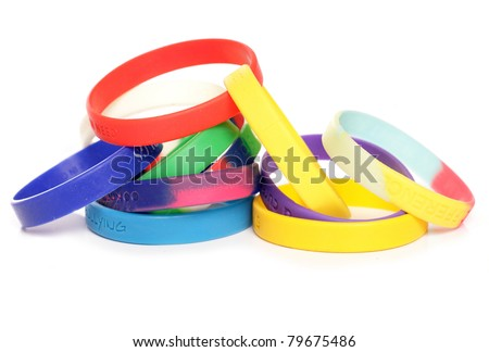 Various charity fundraising wristbands studio cutout - stock photo