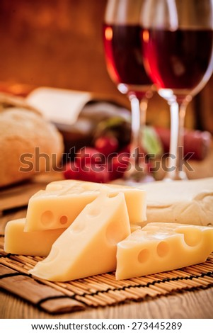 Various cheese recipes and red wine - stock photo