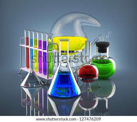 Various chemical vessels with colored chemicals symbolize science - stock photo