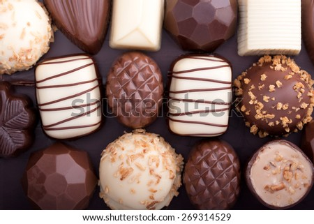 Various chocolate pralines as a background