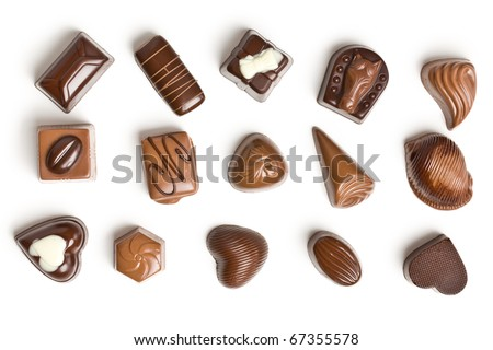 various chocolate pralines isolated on white background