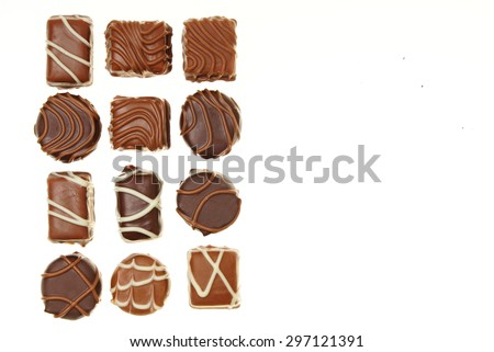 Various chocolates candies on white background, right you can write some text  - stock photo