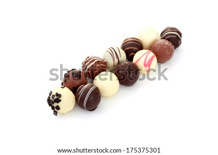 various chocolates on white background - sweet food