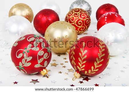 Various christmas baubles with silver stars on floor - stock photo