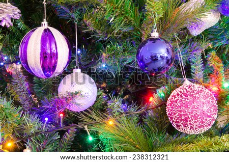 Various christmas decorations on fir - stock photo