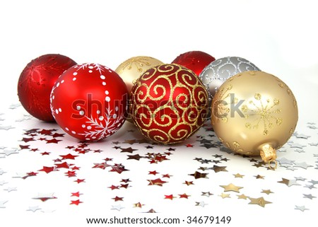 Various christmas tree baubles with silver stars on white background - stock photo