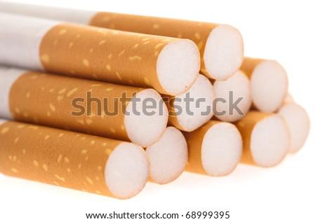 various cigarettes closeup on a white background - stock photo