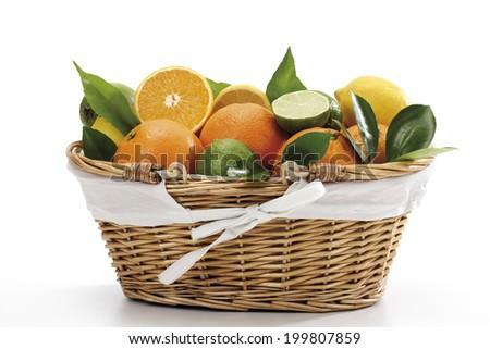 Various citrus fruits in basket - stock photo