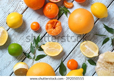 Various citrus fruits on wooden table - stock photo
