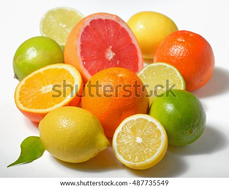 Various citrus fruits over white background