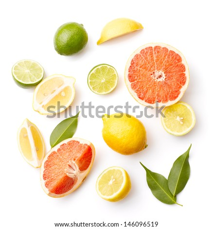Various citrus fruits with leaves on white background
