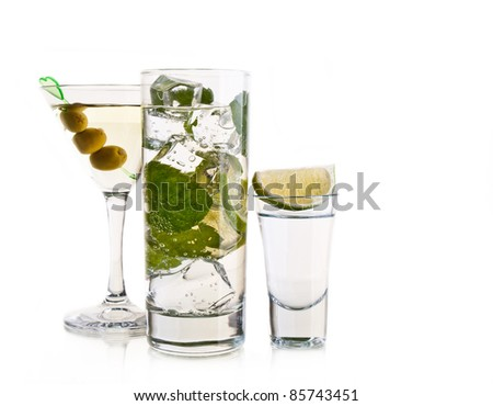Various cocktails and alcohol on white background - stock photo