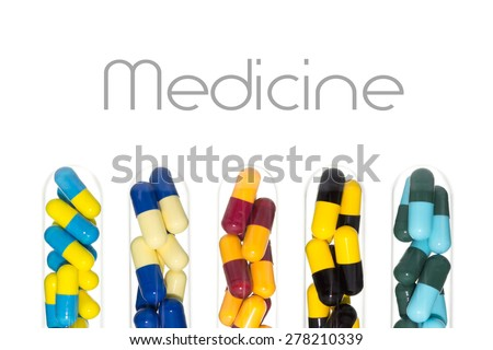 Various color of drug or pill or vitamin capsule in test tube isolated on white background. Background about medical or clinic or pharmacy or hospital story. - stock photo