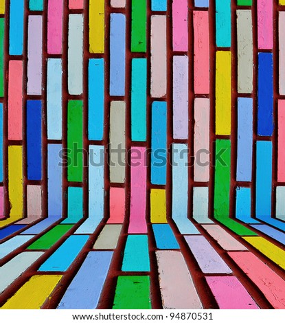 Various color painted on brick room background - stock photo