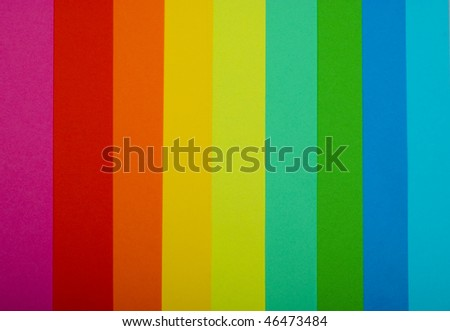various color paper stack like a rainbow close up