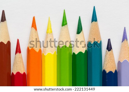 Various color pencils over bright background - stock photo