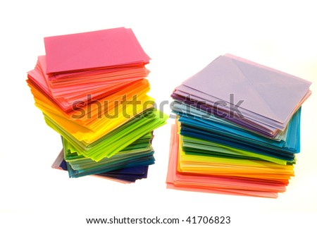 Various color sheets of paper isolated on white background - stock photo