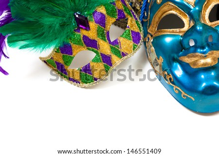 Various colored Mardi gras masks on a white background - stock photo