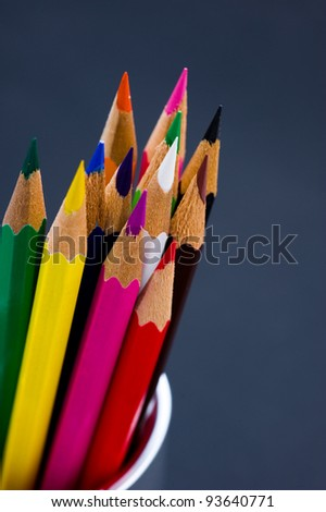 Various Colored Pencils isolated on black background. Macro with extremely shallow depth of field - stock photo