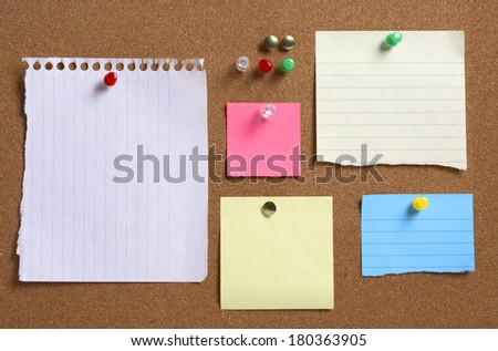 Various colorful blank notes on cork board - stock photo