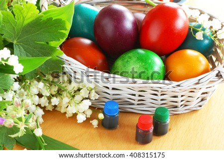 various colorful Easter eggs an basket with colors