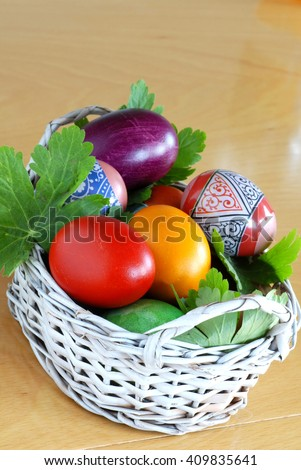 various colorful easter eggs in small punnet - stock photo
