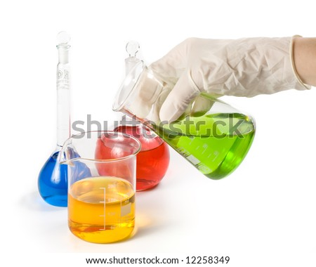 Various colorful flasks and hand in glove over white background