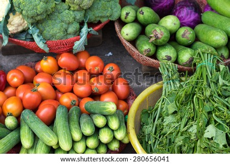various colorful fresh fruits and vegetables at Ho Chi Minh City local market  - stock photo
