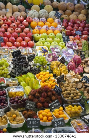 Various colorful fruits and vegetables at market La Boqueria in Barcelona - stock photo