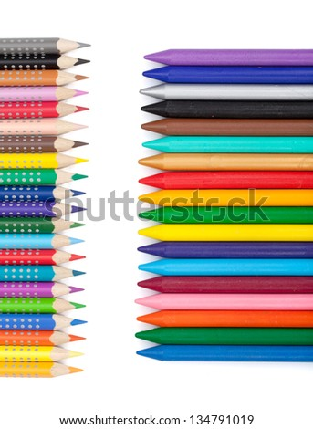 Various colorful pencils and markers. Isolated on white background - stock photo