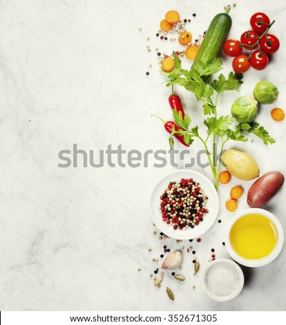Various colorful spices and vegetables on marble table. Bio Healthy food, herbs and spices. Organic vegetables. Vegetarian food. Background layout with free text space. - stock photo