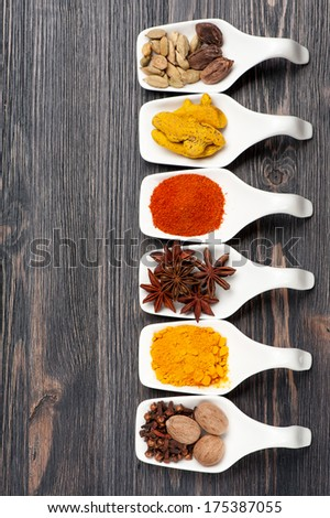 Various colorful spices on a vintage board - stock photo